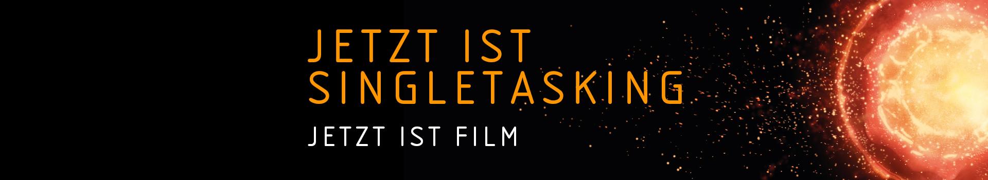 """Ein Banner mit dem Claim """"Jetzt ist Singeltasking. Jetzt ist Film."""", rechts daneben ein Visual einer Supernova."""